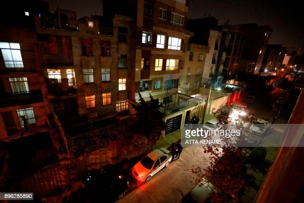 People leave their house and wait in the streets in Tehran overnight on December 21 after an earthquake was felt in the Iranian capital The quake...