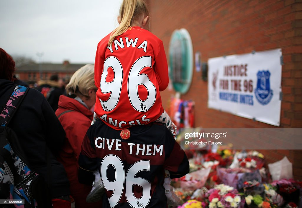 People leave tributes outside Anfield stadium before a memorial service to mark the 27th anniversary of the Hillsborough disaster, on April 15, 2016 in Liverpool, England. Thousands of fans, friends and relatives will take part in the final Anfield memorial service for the 96 victims of the Hillsborough disaster. Earlier this year relatives of the victims agreed that this year's service would be the last. Bells across the City of Liverpool will ring out during a one minute silence in memory of the 96 Liverpool supporters who lost their lives during a crush at an FA Cup semi-final match against Nottingham Forest at the Hillsborough football ground in Sheffield, South Yorkshire in 1989.