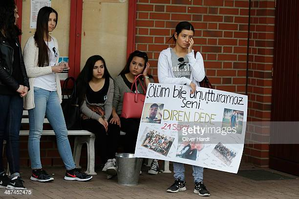 People leave tributes to Diren Dede at his football club SC Teutonia 1910 on April 30 2014 in Hamburg Germany German student Diven was fatally shot...