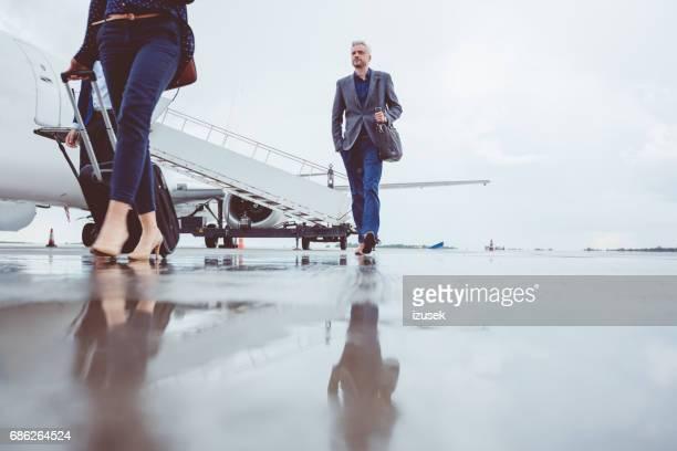 People leaving airplane after landing