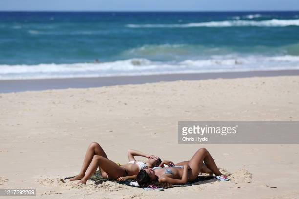 COAST AUSTRALIA APRIL People lie on the beach at Surfers Paradise beach on April 07 2020 in Gold Coast Australia A number of major Gold Coast beaches...