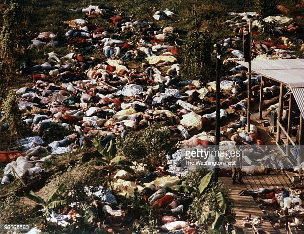 People lie on the ground dead from being forced to commit suicide Over 900 people died by the direction of Rev Jim Jones