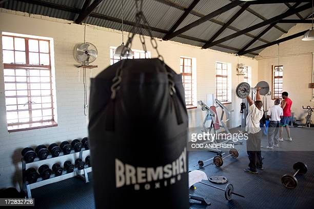 People lift weights in the gym of the Donaldson Orlando Community Centre in the East Orlando Soweto on July 3 2013 In a sweaty township gym where...