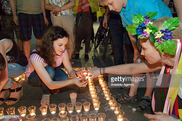 People light candle in commemoration with Crimean Tatars who died when Tatars were exiled in the northeast city Kharkov Ukraine on May 18 2014