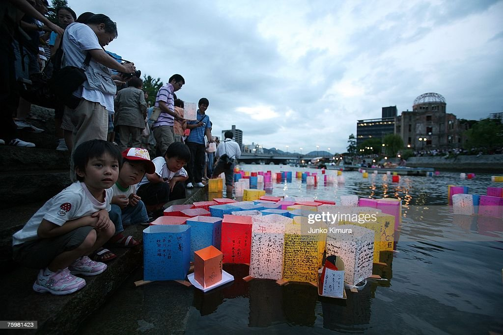 People light candles and float paper lanterns on the Motoyasu river in front of the Atomic Bomb Dome and pray for world peace in memory of the victims of the bomb on the 62nd anniversary of the Hiroshima bomb at the Peace Memorial Park on August 6, 2007 in Hiroshima. Japan. The dropping of the atomic bomb by the U.S. killed an estimated 70,000 people instantly on August 6, 1945 with many thousands more dying over the following years from the effects of radiation. Three days later another atomic bomb was dropped on Nagasaki, ending World War II.