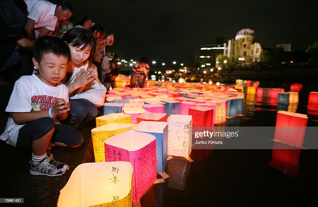People light candles and float paper lanterns on the Motoyasu River in front of the Atomic Bomb Dome and pray for world peace, in memory of the victims of the bomb on the 62nd anniversary of the Hiroshima bomb, at the Peace Memorial Park on August 6, 2007 in Hiroshima. Japan. The dropping of the atomic bomb by the U.S. killed an estimated 70,000 people instantly on August 6, 1945 with many thousands more dying over the following years from the effects of radiation. Three days later another atomic bomb was dropped on Nagasaki, ending World War II.
