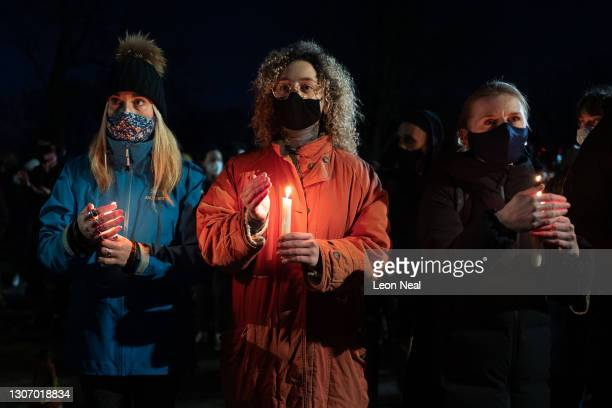 People light candles and pay their respects during a vigil for Sarah Everard on Clapham Common on March 13, 2021 in London, England. Vigils are being...