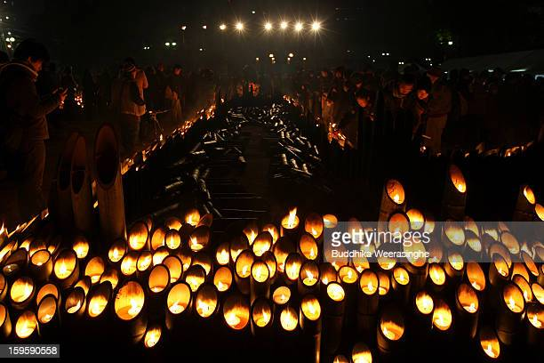 People light candles and pray for victims of the 1995 'Great Hanshin earthquake' during a memorial ceremony on January 17 2013 in Kobe Japan Memorial...