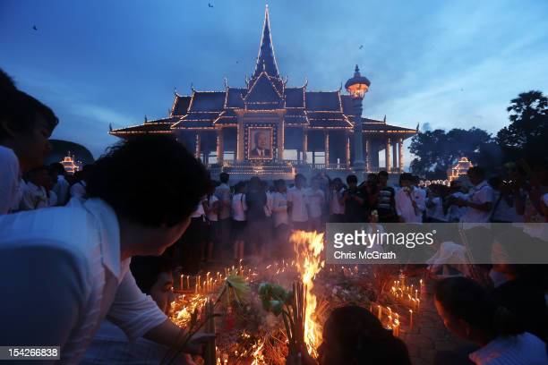People light candles and pray to honour former King Norodom Sihanouk in front of the Royal Palace on October 17, 2012 in Phnom Penh, Cambodia. King...