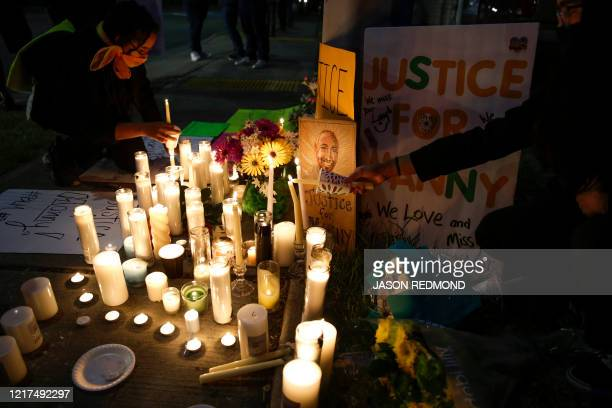 People light candles at a makeshift memorial at the intersection where Manuel Ellis a 33yearold black man died in Tacoma Police custody on March 3...