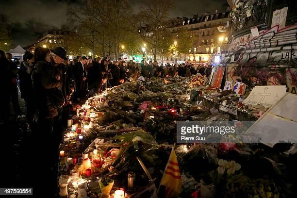 People light candles at a makeshift memorial at the place de la republique monument on November 17, 2015 in Paris, France.Paris remains under...
