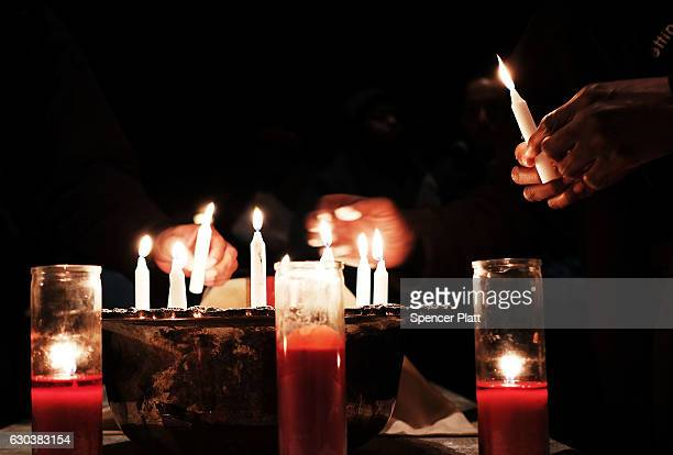 People light candles at a service at Judson Memorial Church on National Homeless Persons' Memorial Day on December 21 2016 in New York CityThe annual...