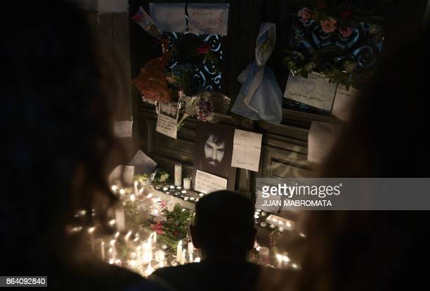 People light candles at the door of the judicial morgue where an autopsy of the corpse of Santiago Maldonado disappeared on August 1st during a...
