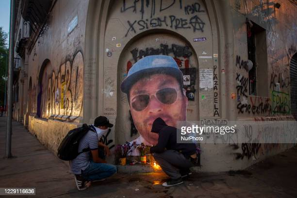 People light candles at the memorial of Mauricio Fredes, one of the fatal victims of police abuse during the social outbreak. Mauricio Fredes died...