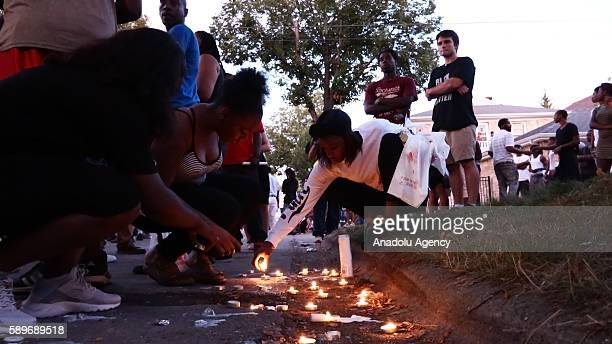 People light candles during a commemoration ceremony, held for Sylville Smith, who was shot and killed by a police officer as he reportedly attempted...