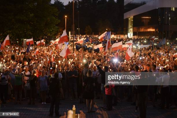 People light candles during a protest against Polish government proposing laws leaving judiciary under the full political control of the government...