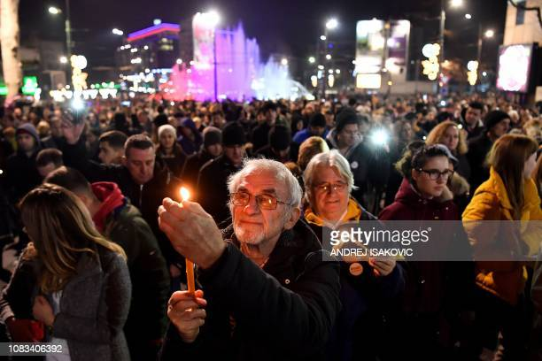 People light candles during a silent march in Belgrade in memory of Serb politician Oliver Ivanovic murdered a year ago in a driveby shooting in...