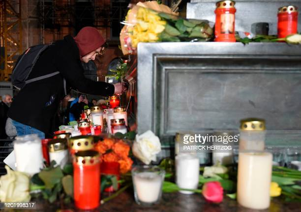 People light candles during a vigil a central place in Hanau, near Frankfurt am Main, western Germany, on February 20 after at least nine people were...