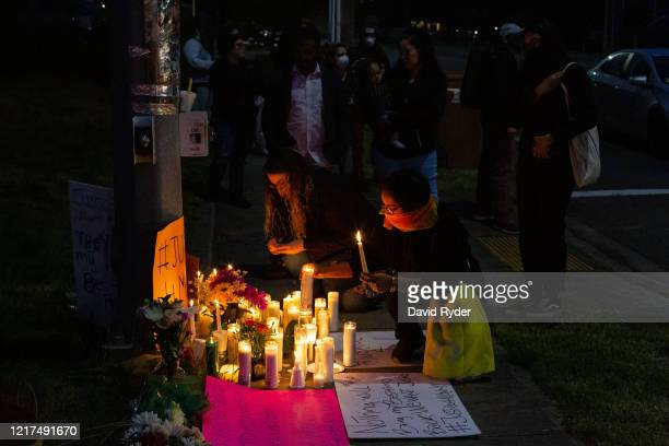 People light candles during a vigil for Manuel Ellis a black man whose March death while in Tacoma Police custody was recently found to be a homicide...