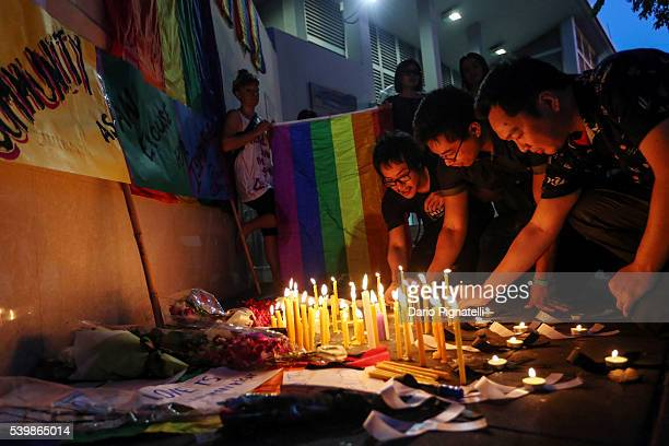 People light candles during a vigil for the attack at the gay club in Orlando on Monday June 13 in Bangkok Thailand