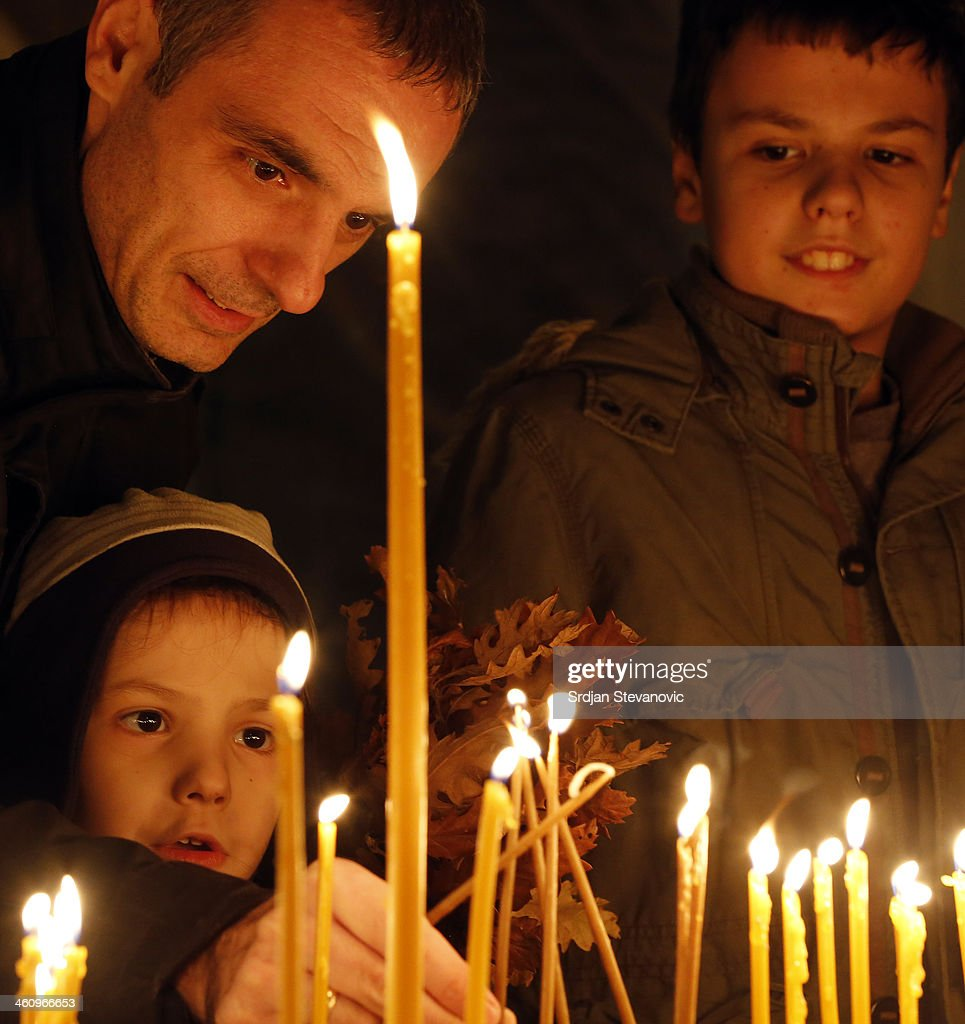 People light candles during the Orthodox Christmas Eve in St. Sava Church on January 6, 2014 in Belgrade, Serbia. Most Orthodox Christians celebrate Christmas according to Julian Calendar on January 7.