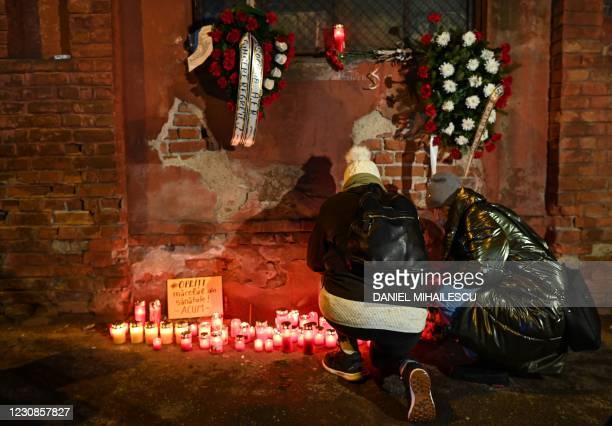 """People light candles in front of """"Matei Bals"""" infectious diseases hospital where a fire broke out in Bucharest January 29, 2021. - At least five..."""