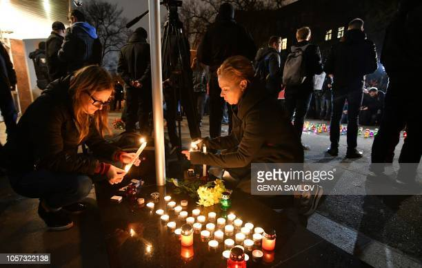People light candles in front of the Ministry of Internal Affairs of Ukraine in remembrance of Ukrainian anticorruption campaigner Kateryna Gandzyuk...