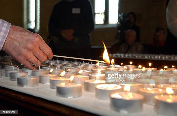People light candles in remembrance for all those who suffered and died on September 11 in New York Pennsylvania and at the Pentagon and for those...
