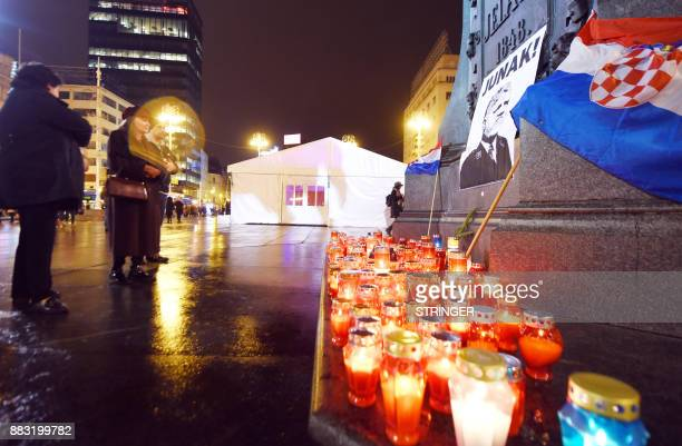 People light candles in tribute to General Slobodan Praljak in Zagreb on November 30 after the Bosnian Croat war criminal took his own life in front...