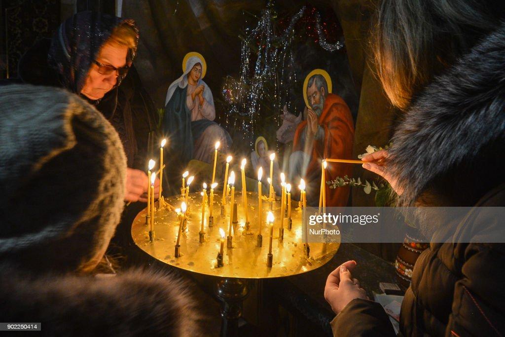 Eastern Orthodox Christmas.People Light Candles On Eastern Orthodox Christmas Day
