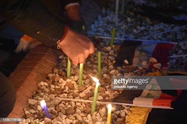 People light candles to commemorate the twin suicide bombing attack at al-Tayaran Square in Baghdad carried out by Daesh terrorist organization, on...