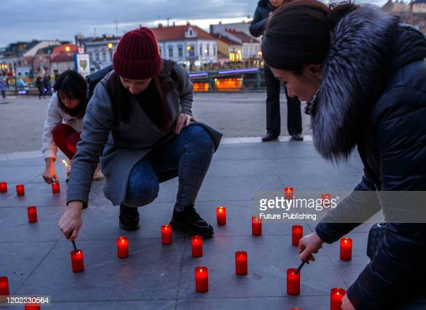 People light candles to honor the memory of the Heavenly Hundred Heroes at the Teatralna Square, Uzhhorod, western Ukraine.- PHOTOGRAPH BY Ukrinform...