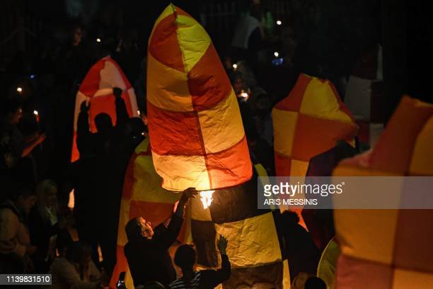 TOPSHOT People light colourful lanterns in Leonidio a seaside town in the Peloponnese to mark the Resurrection of Christ celebrated by the Greek...