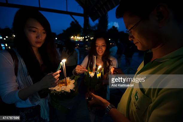 People light incense and candles before floating their krathongs at Wat Chaimongkol during Loy Krathong Festival in Chiang Mai city Loy Krathong is a...
