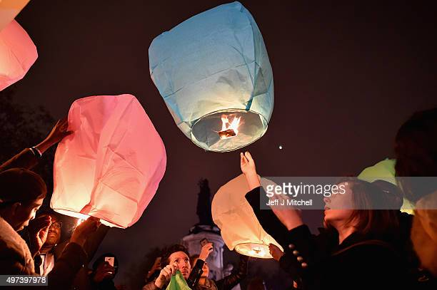 People light lanterns in memory of the victims of Friday's terror attacks at Place de la Republique on November 16 2015 in Paris France A Europewide...
