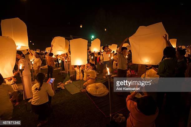 People light sky lanterns during Yi Peng Festival at Lanna Dhutanka