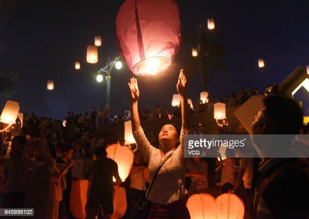 People light up Kongming lanterns and send them to the sky along Lancang River bank during Traditional WaterSprinkling Festival also the New Year...