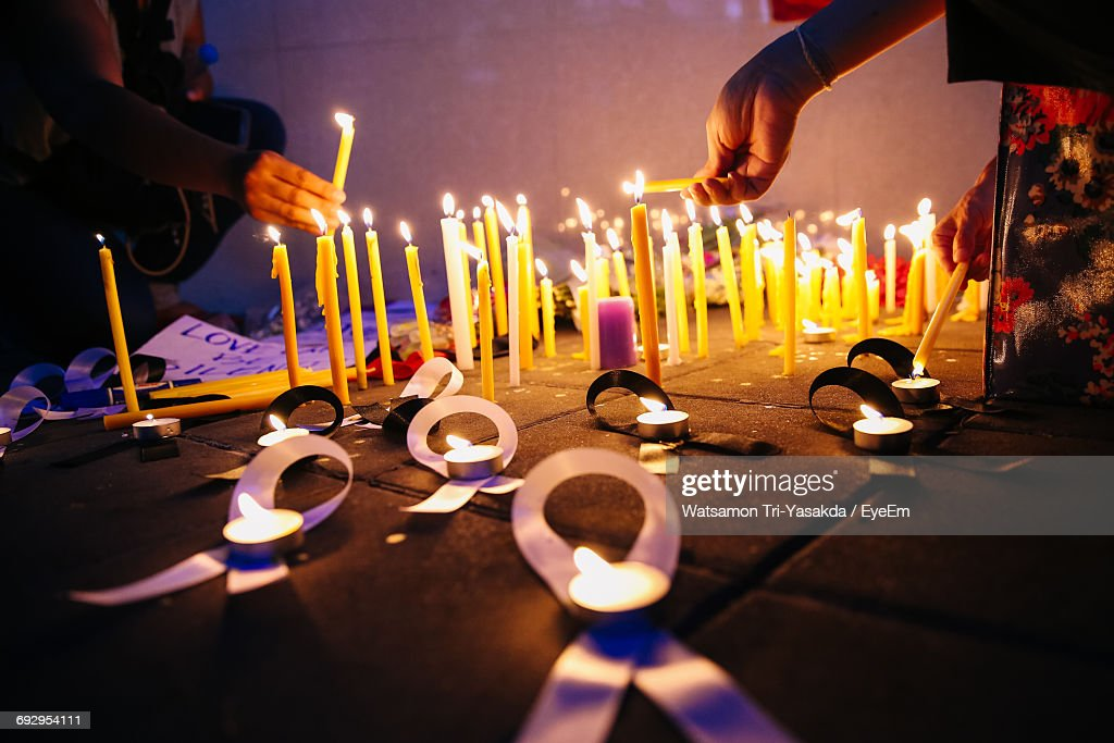 People Lighting Candles During Candlelight Vigil At Night : Stock Photo