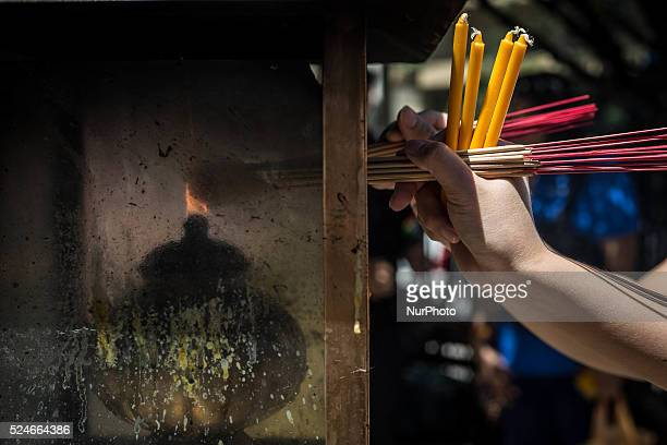 People lights incense at the reopened Erawan Shrine in Central Bangkok on August 19th 2015, after a bomb exploded outside this shrine on August 17th,...