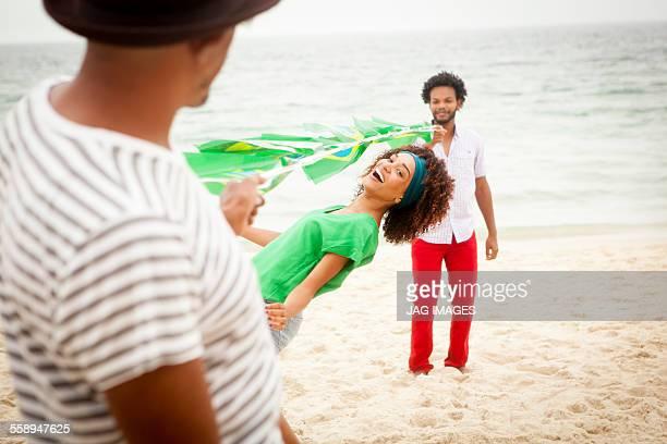 People limbo dancing on beach, Rio de Janeiro, Brazil