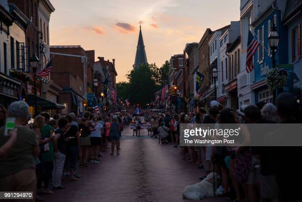 People line on both sides of Main Street during a vigil held in downtown Annapolis Maryland to honor the lives lost in yesterday's mass shooting...
