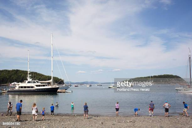 People line the beach near Agamont Park in Bar Harbor In 2016 Bar Harbor and Acadia National Park saw an increase in tourists Park officials said...