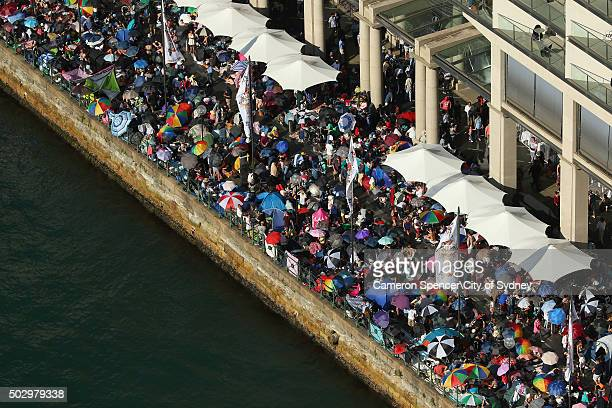 People line the forshore at Circular Quay on New Year's Eve on December 31 2015 in Sydney Australia