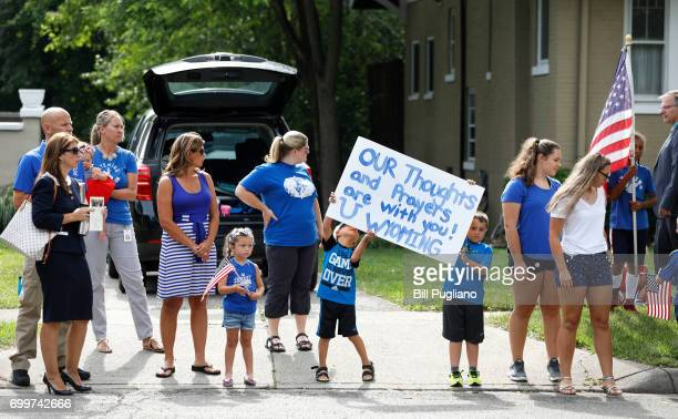 People line the street as the hearse carrying Otto Warmbier passes by on its way to the cemetary June 22 2017 in Wyoming Ohio Otto Warmbier the...