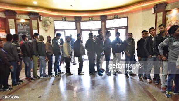 People line up after security check to watch Padmavaat movie at the Delight Cinema on January 25 2018 in New Delhi India According to the film's...