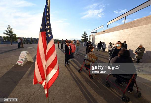 People line up as they wait for a polling place to open at Desert Breeze Community Center on November 3, 2020 in Las Vegas, Nevada. After a...