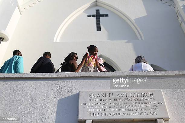 People line up as they wait for the doors to open at Emanuel African Methodist Episcopal Church as it is opened for a Sunday service after a mass...