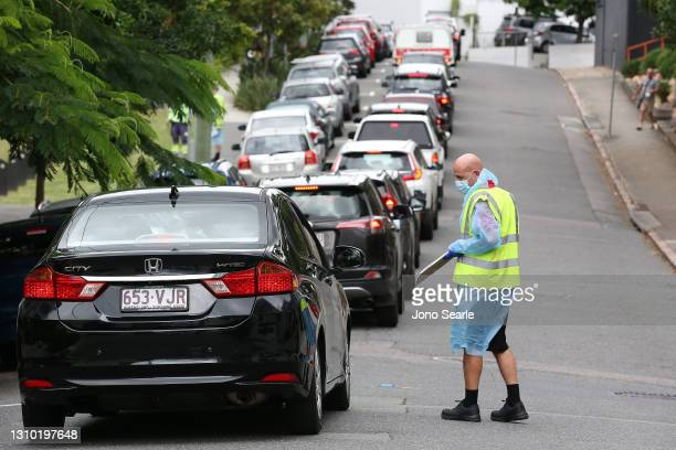 People line up at a drive-in Covid testing center in Bowen Hills on April 01, 2021 in Brisbane, Australia. The Greater Brisbane lockdown will be...