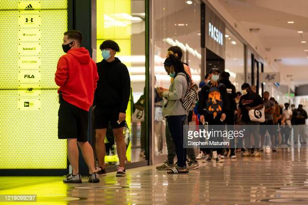 People line up at a store inside the Mall of America before it opens on June 10, 2020 in Minneapolis, Minnesota. Today marks the first day the...