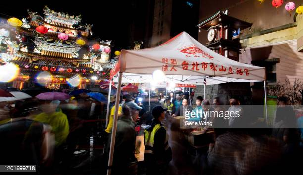 People line up at Songshan Ciyou Temple to get the year of the rat souvenir to start of the Lunar New Year early on January 25 2020 in Taipei Taiwan